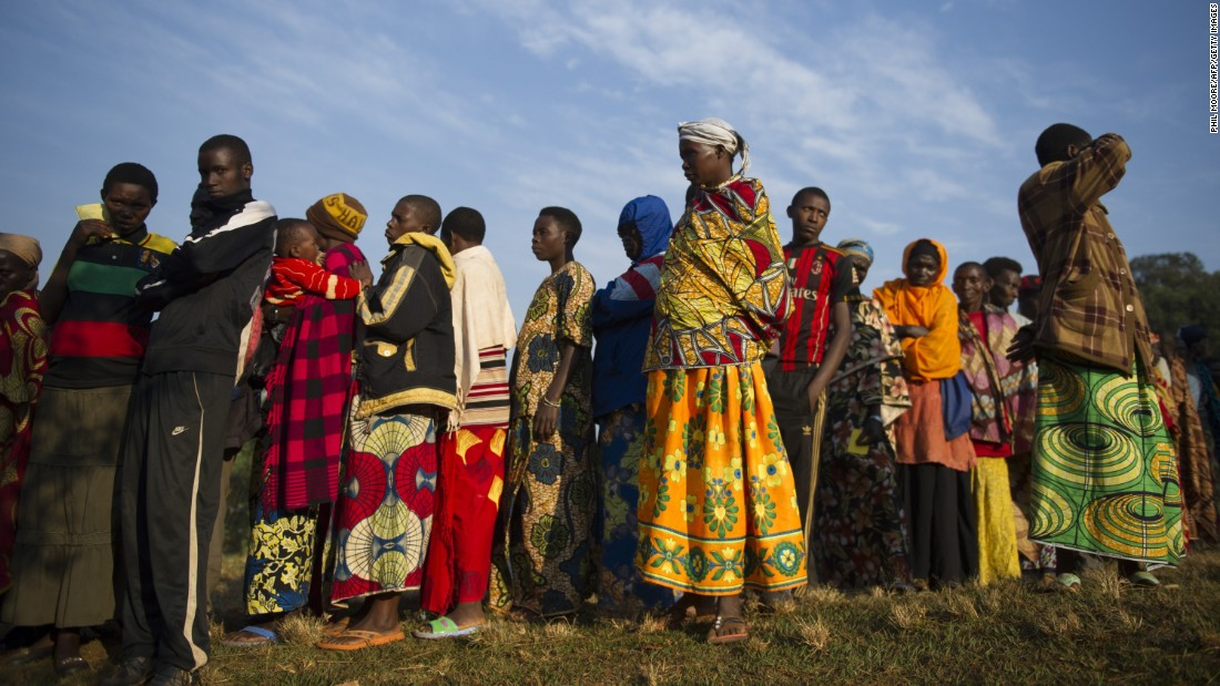 Residents line up before voting in the village of Buye on July 21.