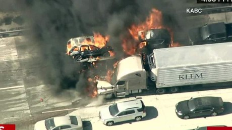 Official: Burning cars on highway a 'horrific scene'