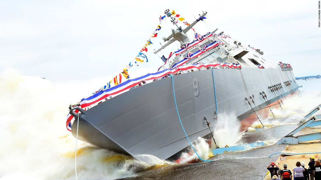 "The future USS Little Rock, shown here at its launch in July 2015, is one of the Navy's monohull variants of the littoral combat ship, or LCS. The LCS also comes in a trimaran, or multihull, variant.<br /> <br />The Little Rock is 378 feet long with a displacement weight of 3,000 tons.<br /> <br />The service has 24 of the vessels in the fleet under construction or under contract.<br /> <br />According to a Navy fact file, ""The LCS is a fast, agile, focused-mission platform, yet capable of open-ocean operation. It is designed to defeat asymmetric 'anti-access' threats such as mines, quiet diesel submarines and fast surface craft.""<br /> <br />The price of an LCS has been put at around $350 million, plus weapons systems."