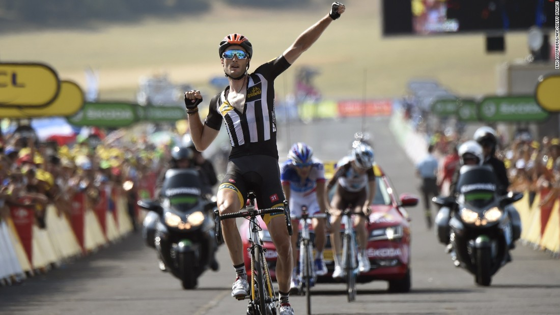 MTN-Qhubeka's Stephen Cummings celebrates as he crosses the finish line at the end of the 178,5 km 14th stage. It was the first Tour victory for an African team.