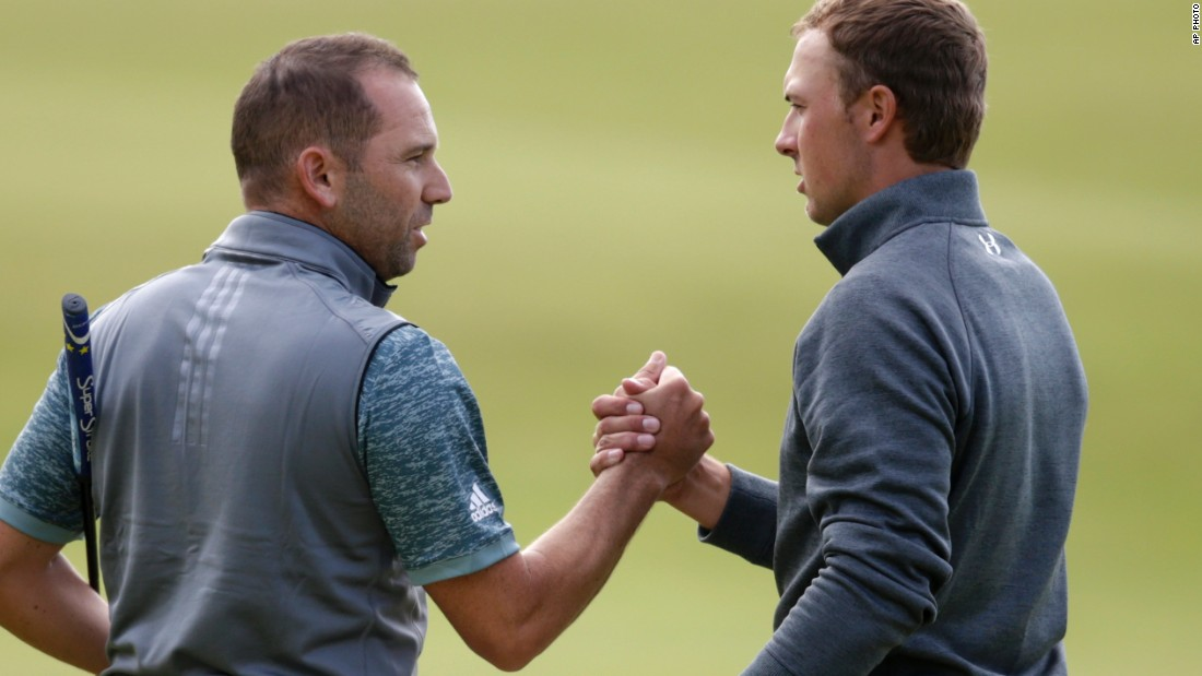 Spieth and playing partner Sergio Garcia of Spain shake hands after the finish of their rounds.