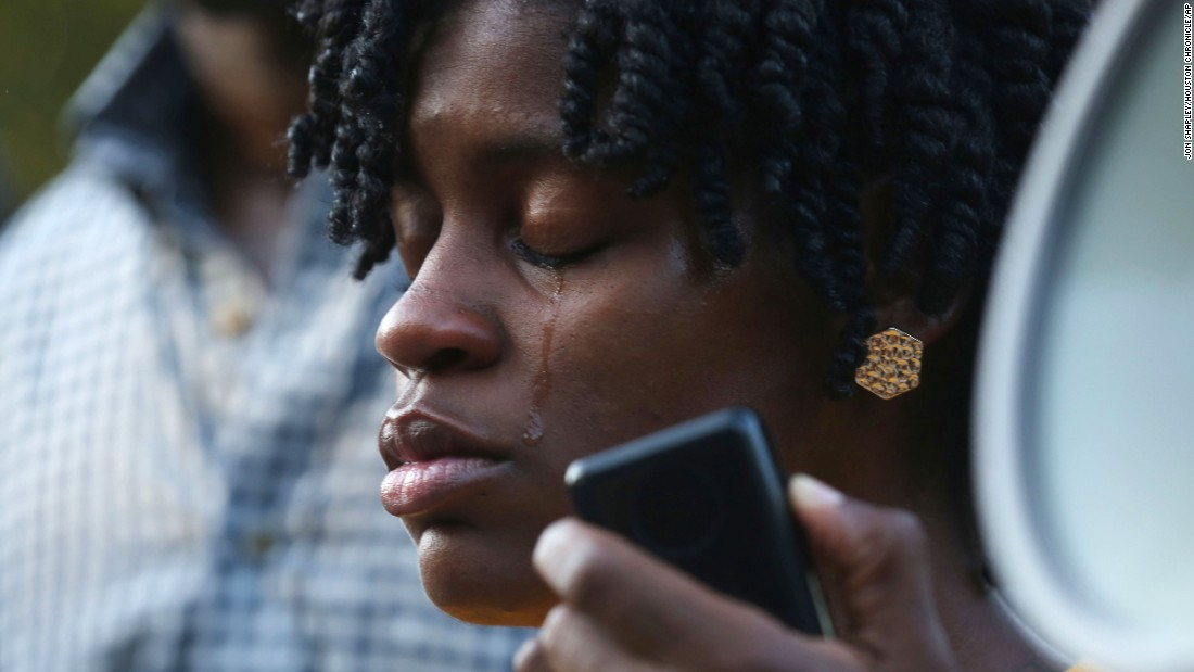 Angel Duncan cries Sunday, July 19, while speaking at a vigil at Bland's alma mater.
