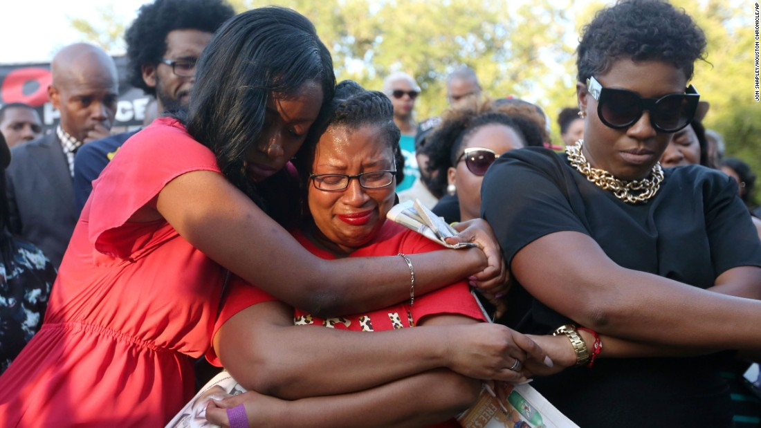 "Lanitra Dean hugs Bland's friend Carlesha Harrison during the Prairie View vigil on July 19. Bland had been arrested by the Texas Department of Public Safety, which said she became ""argumentative and uncooperative"" during a traffic stop."