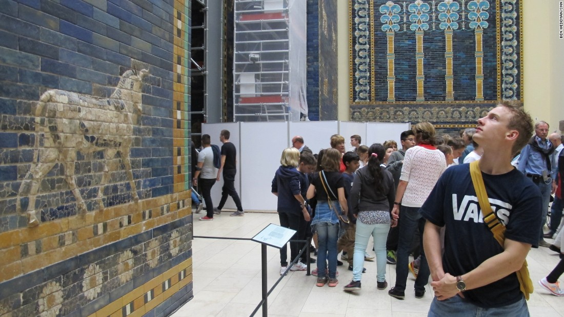 A visitor to Berlin's Pergamon Museum admires the reconstructed Ishtar Gate from Babylon, Iraq. The creatures shown on the gate come from hundreds of thousands of fragments that were found by a German archaeological expedition in Babylon from 1899 until 1917.