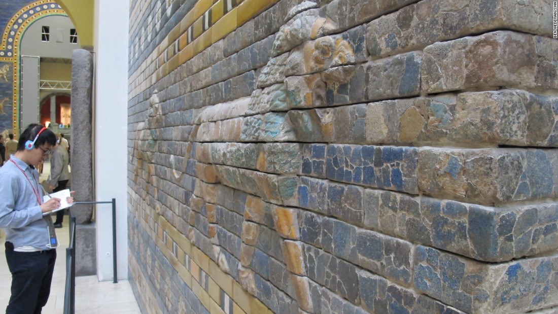 A museum visitor takes notes in front of one of the figures on Babylon's Ishtar Gate. A replica now stands in Babylon. The original was built in about 575 B.C. by order of King Nebuchadnezzar II as the eighth gate to the inner city. Archaeologists say excavations and conservation work carried out under Saddam Hussein's rule greatly despoiled the site.