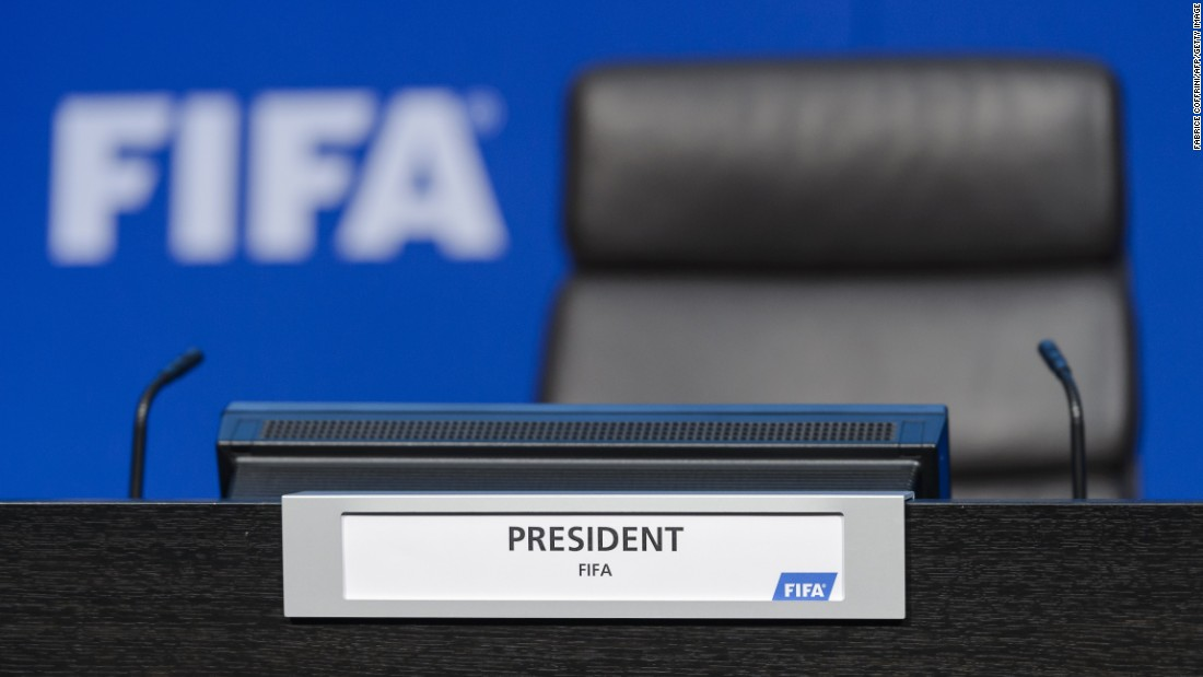 Before being ushered off the stage, Nelson showered Blatter with what appeared to be fake money.