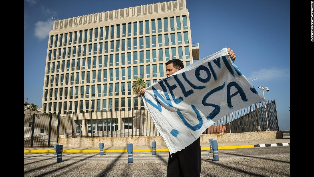 A man waves a banner in front of the U.S. Embassy in Havana on July 20.