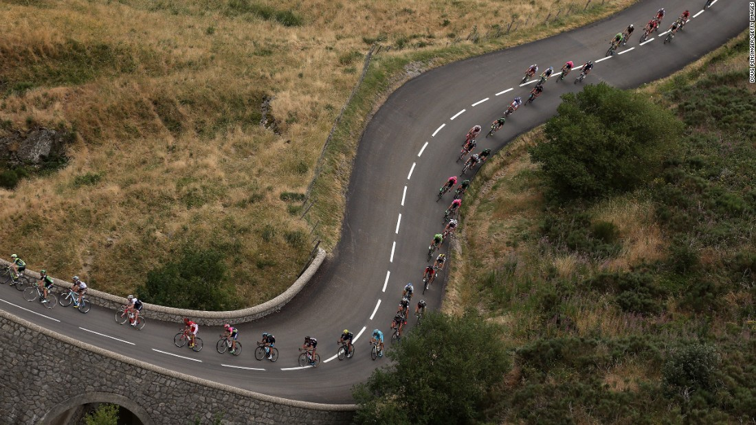 The peloton weaves its way through La Souche, France, during the 15th stage of the Tour de France on Sunday, July 19. The race will conclude July 26 in Paris.