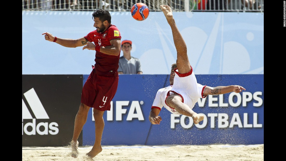 Switzerland's Dejan Stankovic performs an overhead kick near Portugal's Torres during a quarterfinal match at the Beach Soccer World Cup on Thursday, July 16.