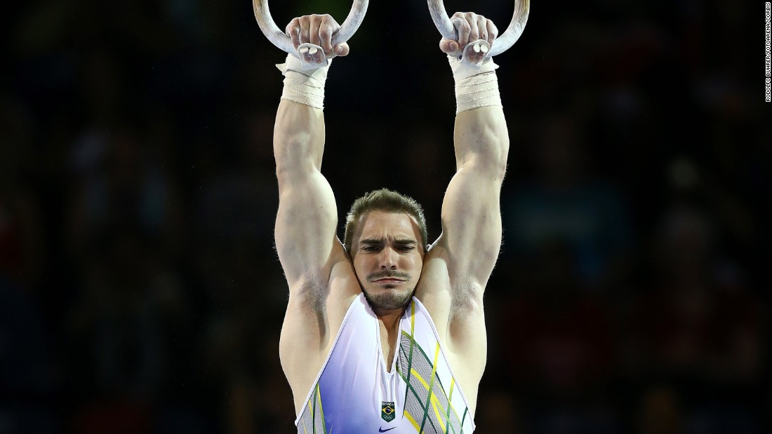 Brazilian gymnast Arthur Zanetti hangs from the rings during the Pan American Games in Toronto on Tuesday, July 14. Zanetti won gold in the event.