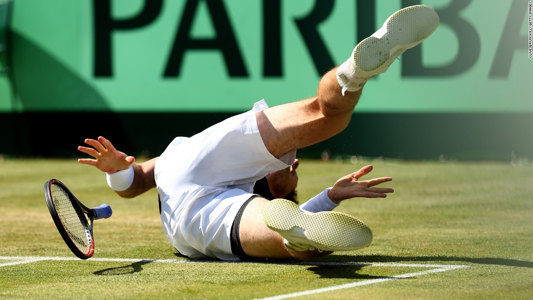 Andy Murray falls while playing Gilles Simon in a Davis Cup quarterfinal match Sunday, July 19, in London. Murray won the match in four sets, helping Great Britain advance to the semifinals for the first time since 1981.