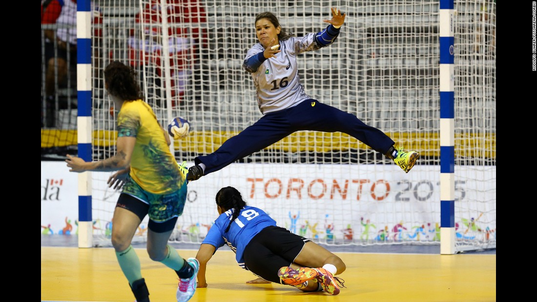 Mayssa Pessoa, goalkeeper for Brazil's handball team, stretches for a save while playing Puerto Rico in the Pan American Games on Thursday, July 16. Brazil won the match 38-21.