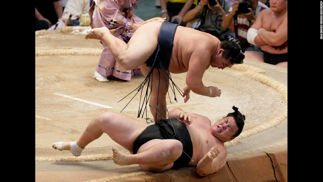 Sumo wrestler Kakuryu, top, throws Ikioi during the Grand Sumo Tournament in Nagoya, Japan, on Sunday, July 19.