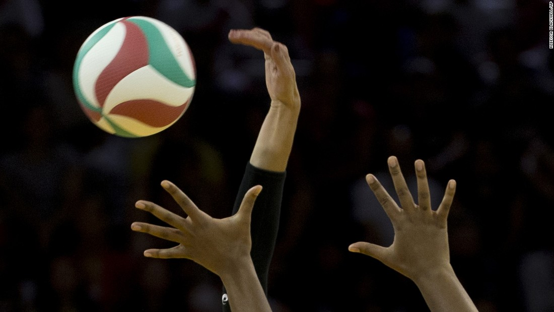 U.S. volleyball player Lauren Paolini curves her hand to spike the ball while playing Peru at the Pan American Games on Thursday, July 16.