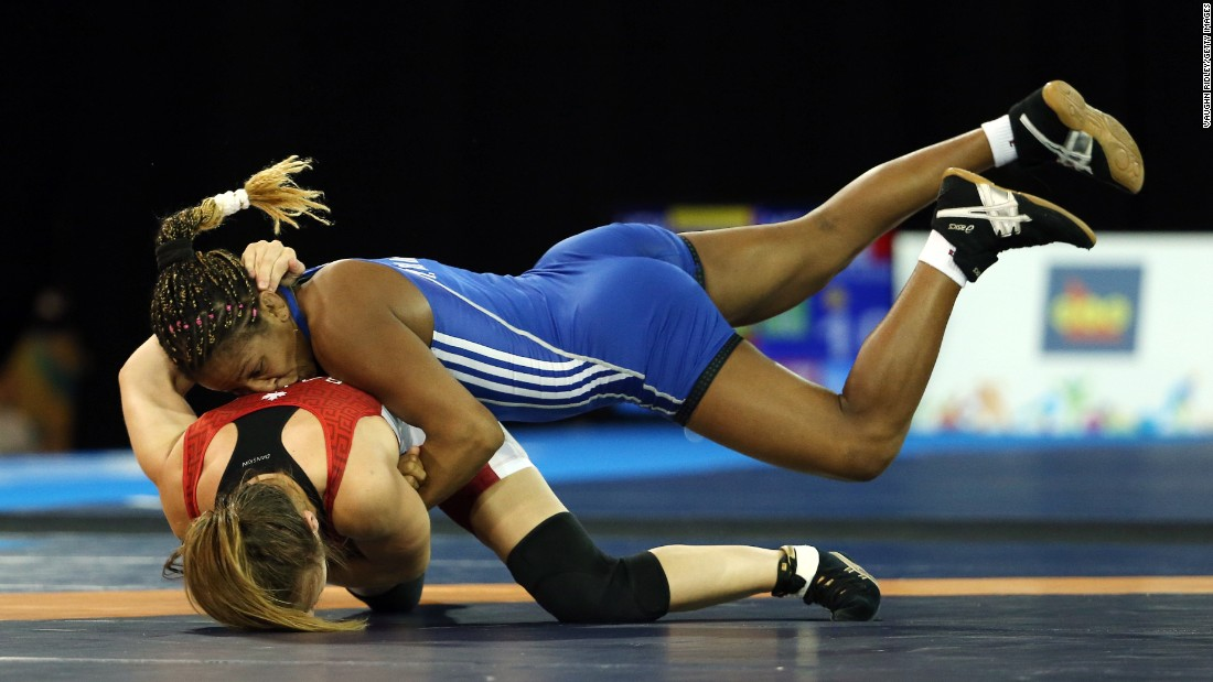 Cuba's Yamilka Del Valle, top, wrestles Canada's Brianne Barry at the Pan American Games on Thursday, July 16.