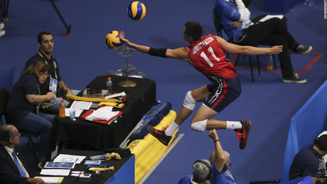 U.S. volleyball player Micah Christenson leaps outside the court for a return while playing Brazil at the World League Tournament on Thursday, July 16. Brazil won the match in Rio de Janeiro, but it was the United States who would eventually advance to the tournament semifinals and finish in third place.