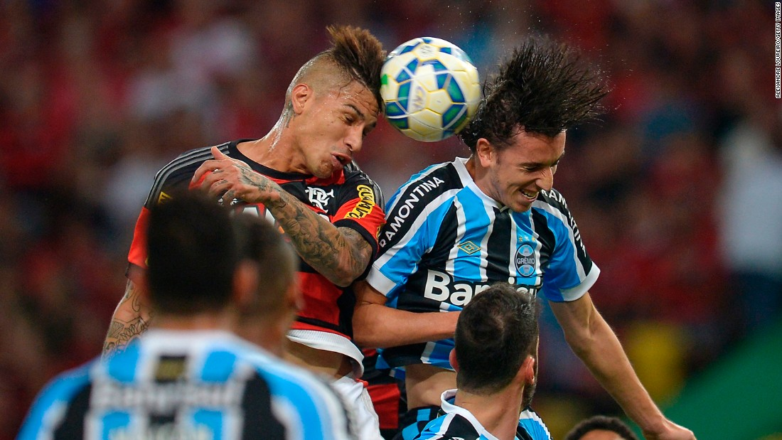 Flamengo's Paolo Guerrero, left, battles for the ball with Gremio's Geromel during a Brazilian league match in Rio de Janeiro on Saturday, July 18.