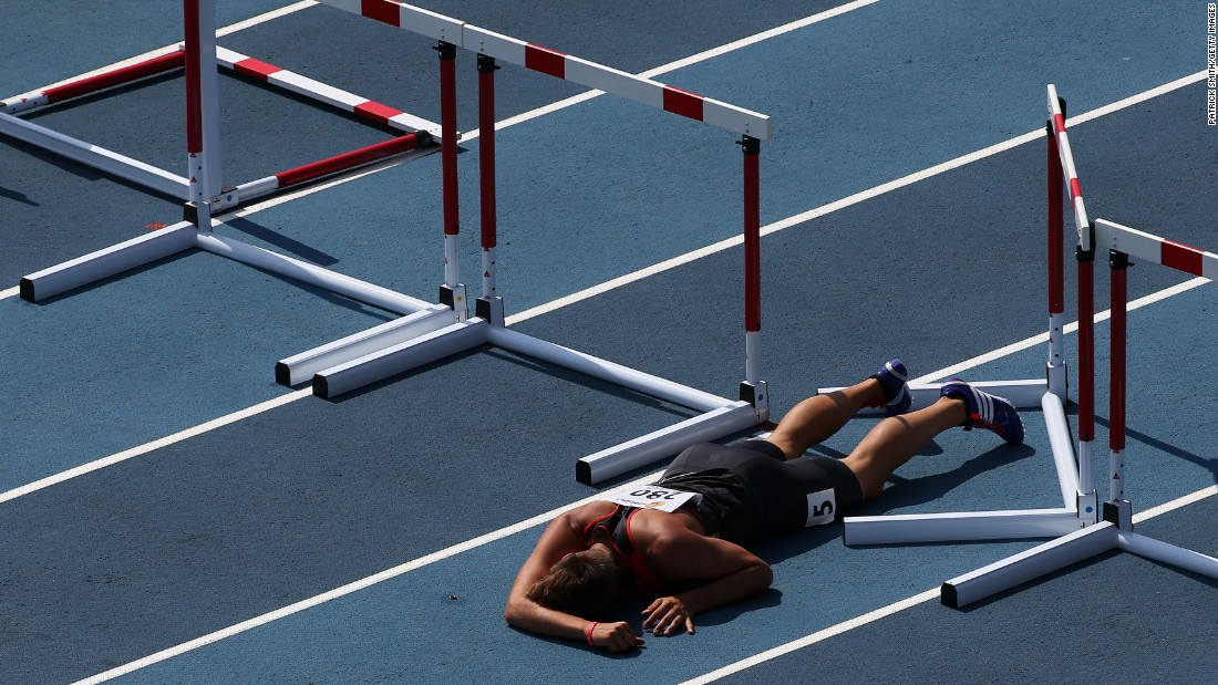German decathlete Maximilian Vollmer lies on the ground after falling during the 110-meter hurdles Thursday, July 16, at the IAAF World Youth Championships in Cali, Colombia.