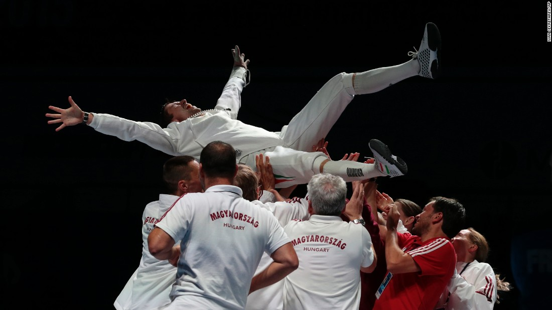 Hungarian fencer Geza Imre is thrown in the air by his teammates after he won gold in the individual epee competition at the World Fencing Championships in Moscow on Wednesday, July 15.