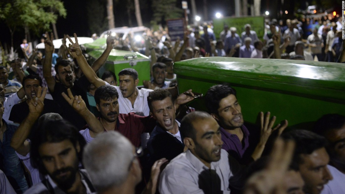 People carry victims' coffins through the streets of Gaziantep, Turkey, on July 20.