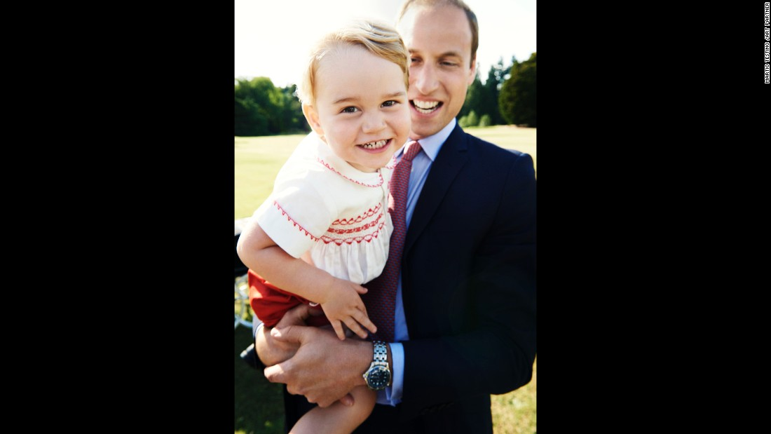 Prince George is held by his father, Prince William, in this photo released July 21, 2015 -- the day before his second birthday.