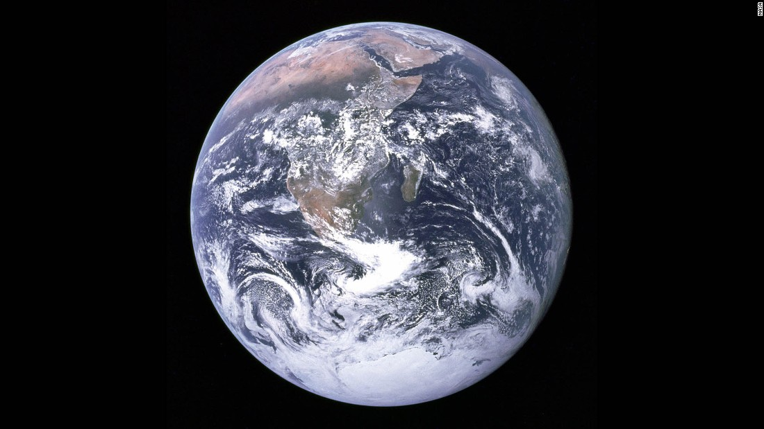 """The Blue Marble"" is a famous photograph of the Earth taken on December 7, 1972, by the crew of the Apollo 17 spacecraft en route to the Moon at a distance of about 29,000 kilometers (18,000 miles). It shows Africa, Antarctica, and the Arabian Peninsula."