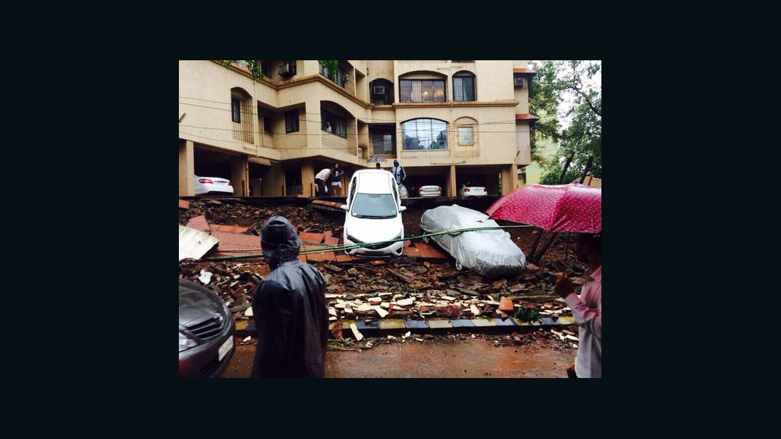 A local resident took a photo of a parking lot in Bandra, Mumbai, that collapsed due to heavy rainfall. #MumbaiRains became a top trend on Twitter in India as users snapped pictures and commuters shared travel details.