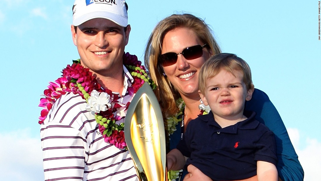 The Johnsons and son Will pose with the trophy after Zach won the PGA Tour's 2009 Sony Open in Hawaii.