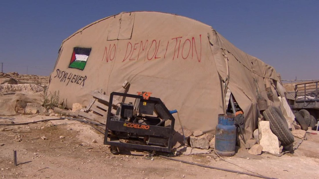 "Susiya, a cluster of tents and ramshackle outbuildings, has been flattened several times in the past. ""At any time, the bulldozers could come and wipe this place off the map,"" explains Rabbi Arik Ascherman."