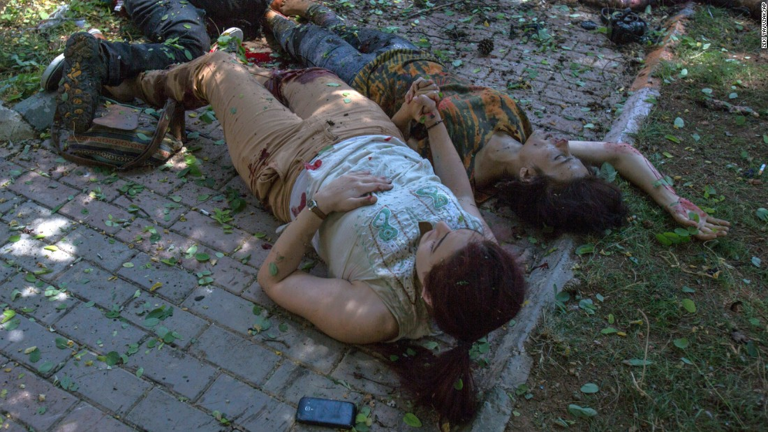"A wounded woman, left, holds the hand of another woman who is about to die just after <a href=""http://www.cnn.com/2015/07/20/world/gallery/terror-attack-turkey/index.html"" target=""_blank"">an explosion rocked the Turkish city of Suruc</a> on Monday, July 20. More than 30 people were killed and at least 100 others were wounded in what Turkish officials called a terrorist attack near the Syrian border."