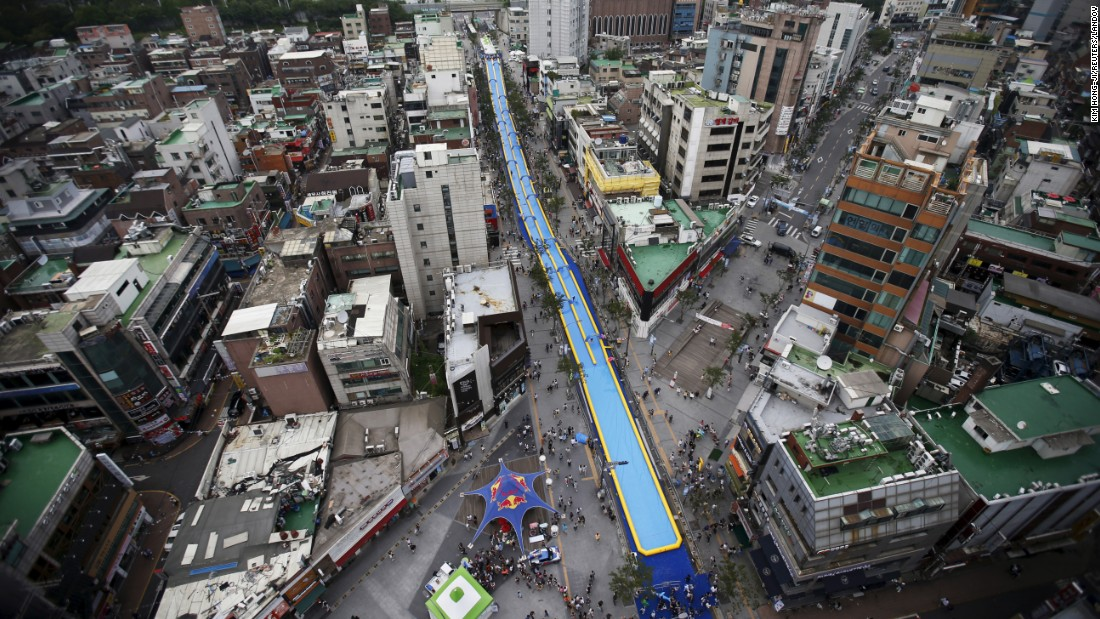 A water slide measuring 1,148 feet stretches through the center of Seoul, South Korea, on Sunday, July 19.