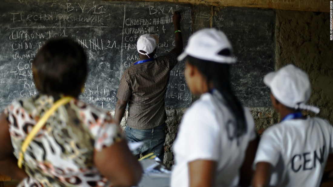 "Election officials count votes at a polling station in Bujumbura, Burundi, on Tuesday, July 21. President Pierre Nkurunziza <a href=""http://www.cnn.com/2015/07/21/world/gallery/burundi-elections/index.html"" target=""_blank"">is bidding for a third term in office,</a> although critics say a third term is prohibited by the peace accord that ended the country's civil war in 2003."
