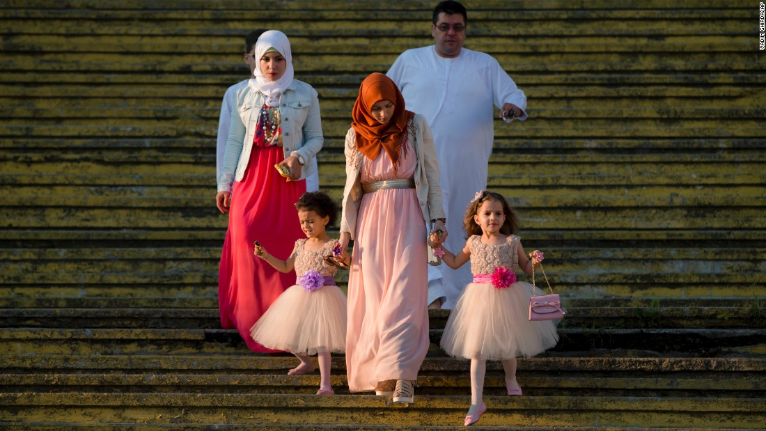 A family arrives for Eid al-Fitr prayers in Bucharest, Romania, on Friday, July 17. The Eid al-Fitr festival marks the end of Ramadan, the Islamic holy month.