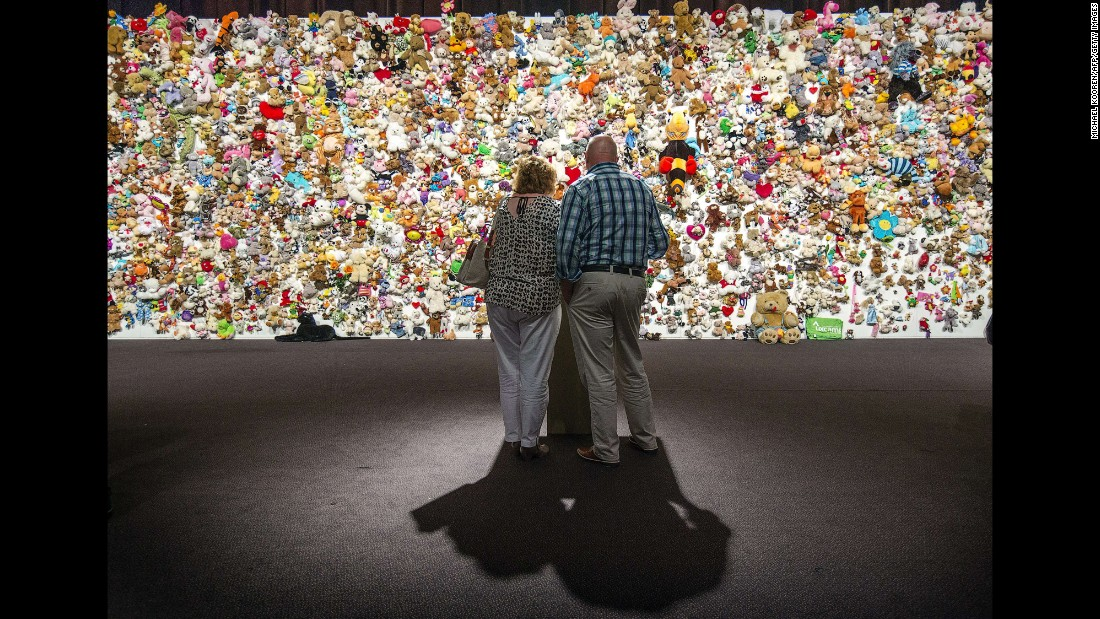"Mourners in Nieuwegein, Netherlands, gather in front of a ""hedge of compassion"" -- made of thousands of stuffed animals -- prior to a ceremony Friday, July 17, for those who died in the crash of Malaysia Airlines Flight 17. Flight 17 was shot down over Ukraine last year, killing all 298 people aboard. Of the people who died, 193 were Dutch citizens."