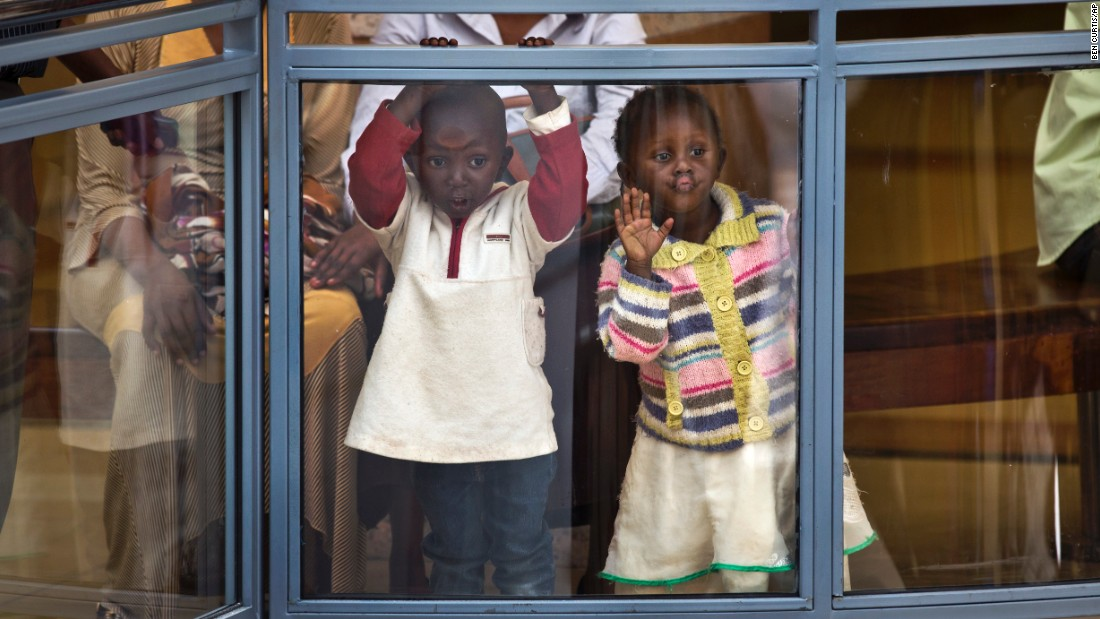 "Two children look out from an upper level of the <a href=""http://www.cnn.com/2015/07/18/africa/kenya-westgate-mall-reopens/"" target=""_blank"">reopened Westgate Shopping Mall</a> on Saturday, July 18, nearly two years after a terrorist attack left at least 67 people dead there in Nairobi, Kenya."