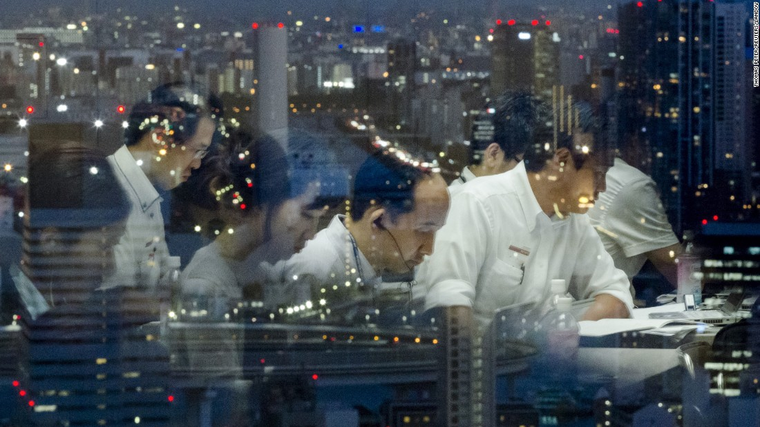 "Reporters are reflected in a window overlooking Tokyo as they work at the Toshiba headquarters following a news conference on Tuesday, July 21. Toshiba's chief executive and president <a href=""http://money.cnn.com/2015/07/21/investing/toshiba-ceo-resigns/index.html"" target=""_blank"">resigned Tuesday</a> over an accounting scandal that has rocked the company, which makes everything from consumer electronics to nuclear energy technology. Eight board members also resigned as part of a major management reshuffle."