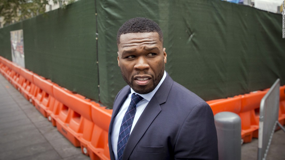 "Rapper 50 Cent exits a court in New York on Tuesday, July 21. The rapper <a href=""http://money.cnn.com/2015/07/17/news/50-cent-bankruptcy-lawsuits/index.html"" target=""_blank"">said he filed for bankruptcy</a> because he is facing some hefty lawsuits."