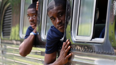 Tamir Brooks, right, and Sami Wylie look out of the windows of the 1947 vintage bus they are traveling on as they leave the Civil Rights Institute in Birmingham, Alabama, on June 24.