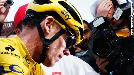 Chris Froome is surrounded by the media after keeping the yellow jersey ahead of the final stage of the Tour de France.