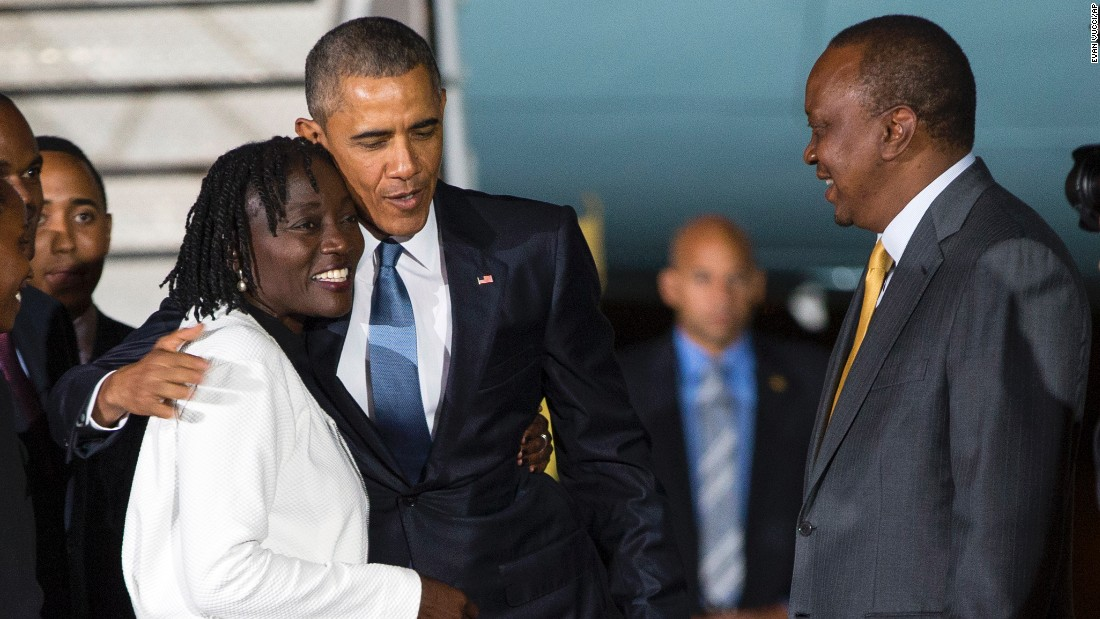 Kenyatta watches as Obama hugs his half-sister Auma on July 24.