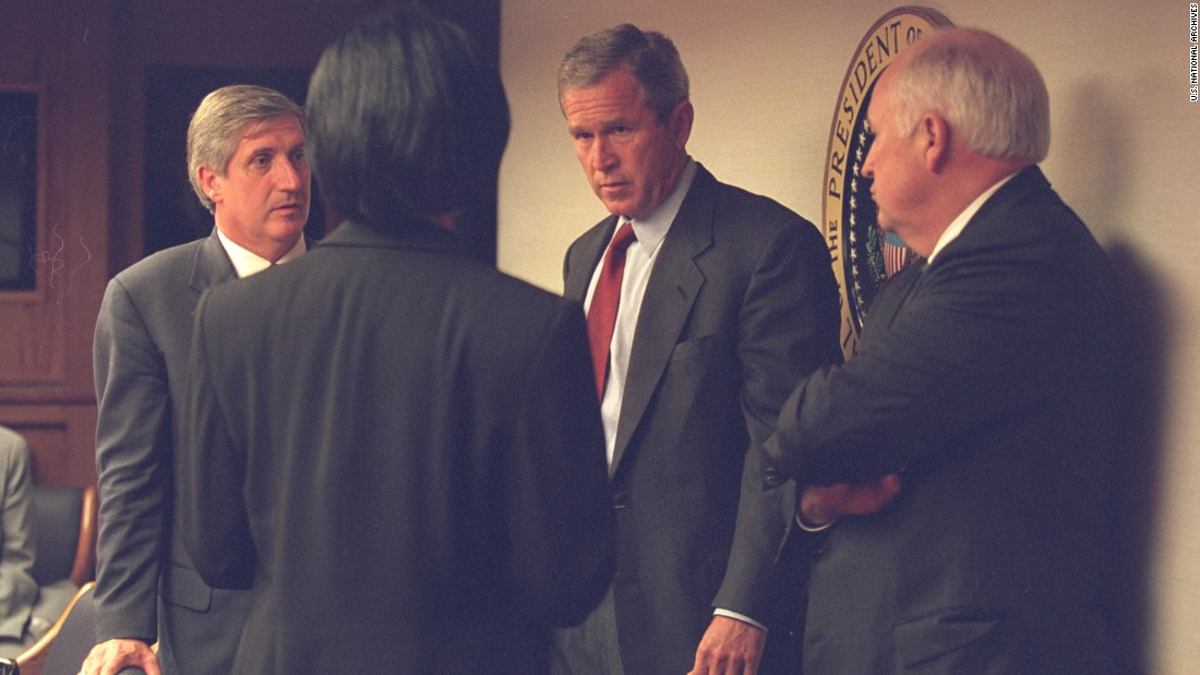 "<a href=""http://edition.cnn.com/2002/ALLPOLITICS/09/11/ar911.king.cheney/"">President Bush speaks</a> with Vice President Cheney and members of his senior staff. The vice president had a few words with the president just before the latter's address to the nation. CIA Director George Tenet watched from the bunker, waiting for Bush to convene a late-night meeting of the National Security Council."