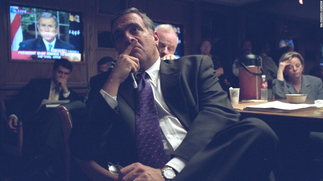 "CIA Director George Tenet listens to President Bush's <a href=""http://edition.cnn.com/2001/US/09/11/bush.speech.text/"">televised address. </a>The President said, ""Terrorist attacks can shake the foundations of our biggest buildings, but they cannot touch the foundation of America. These acts shatter steel, but they cannot dent the steel of American resolve."""
