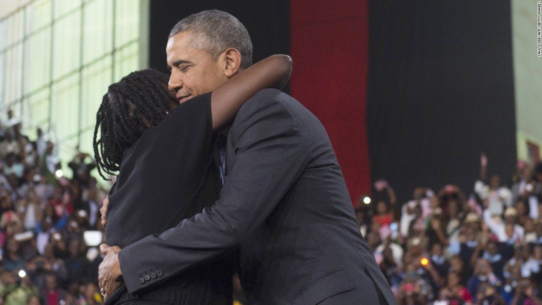 "Obama embraces his half-sister Auma Obama during an event at the Moi International Sports Center on July 26. She introduced Obama to the crowd, saying her brother ""continues to be very attached to us."" The President spent portions of each night in Kenya with relatives."