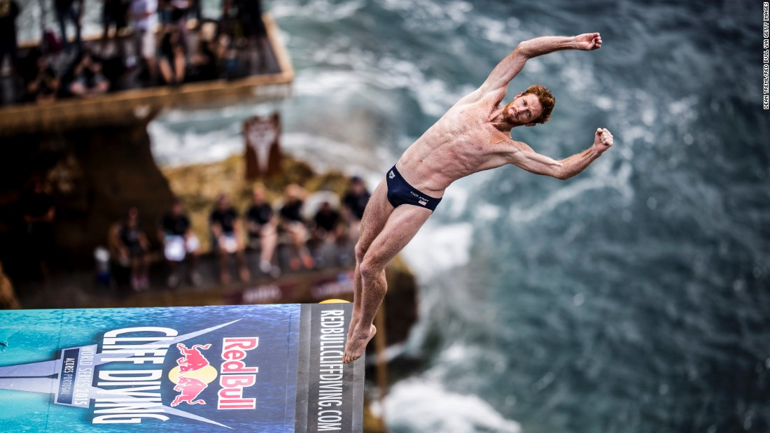 American diver Andy Jones leaps from the 27-meter platform during the fifth stop of the Red Bull Cliff Diving World Series -- featuring professional divers and some of the world's best cliffs -- on the islet of Vila Franca do Campo, Azores, Portugal, on July 18, 2015.