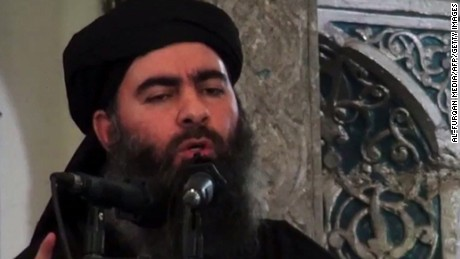 An image grab taken from a propaganda video released on July 5, 2014 by Al-Furqan Media allegedly shows the leader of the Islamic State (IS) jihadist group Abu Bakr al-Baghdadi, aka Caliph Ibrahim, adressing Muslim worshippers at a mosque in the militant-held northern Iraqi city of Mosul. Baghdadi, the self-proclaimed caliph of the brutal jihadist Islamic State (IS) group that has seized large chunks of Iraq and Syria, made the AFP shortlist of most influential people of 2014. AFP PHOTO / HO / AL-FURQAN MEDIA