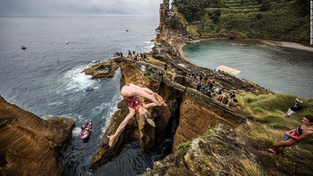 Lysanne Richard of Canada dives into the waters around Vila Franca do Campo on July 17, 2015. The islet is created by the crater of an ancient, submerged volcano.