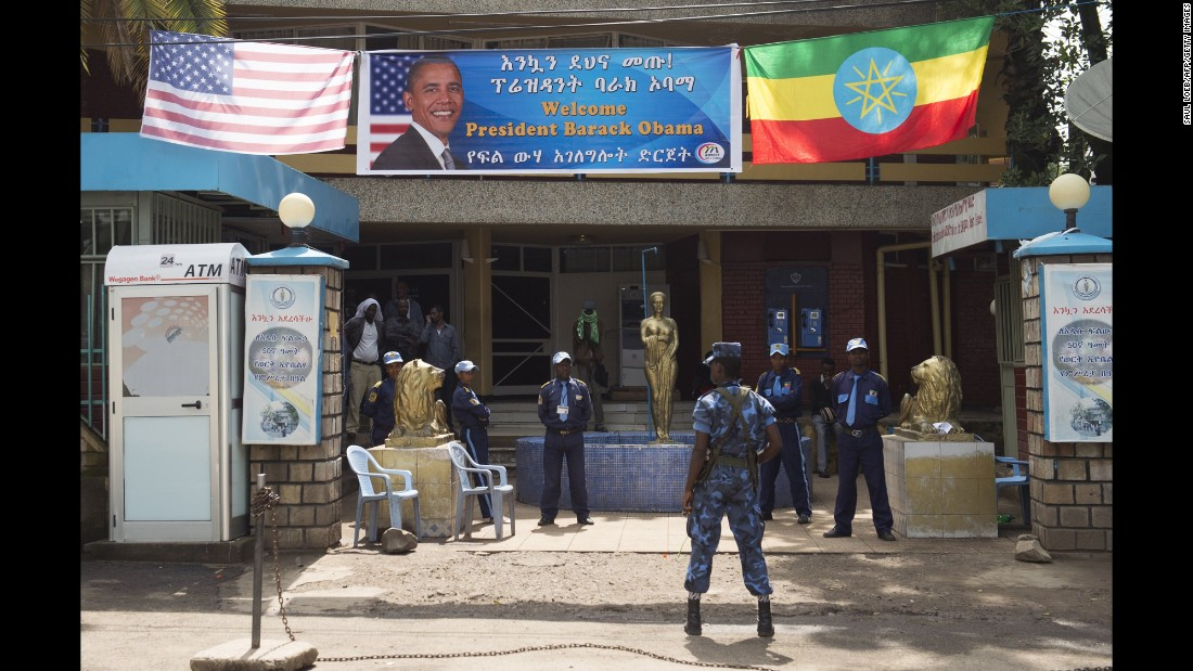Security stands guard as Obama's motorcade drives to the National Palace in Addis Ababa on July 27.