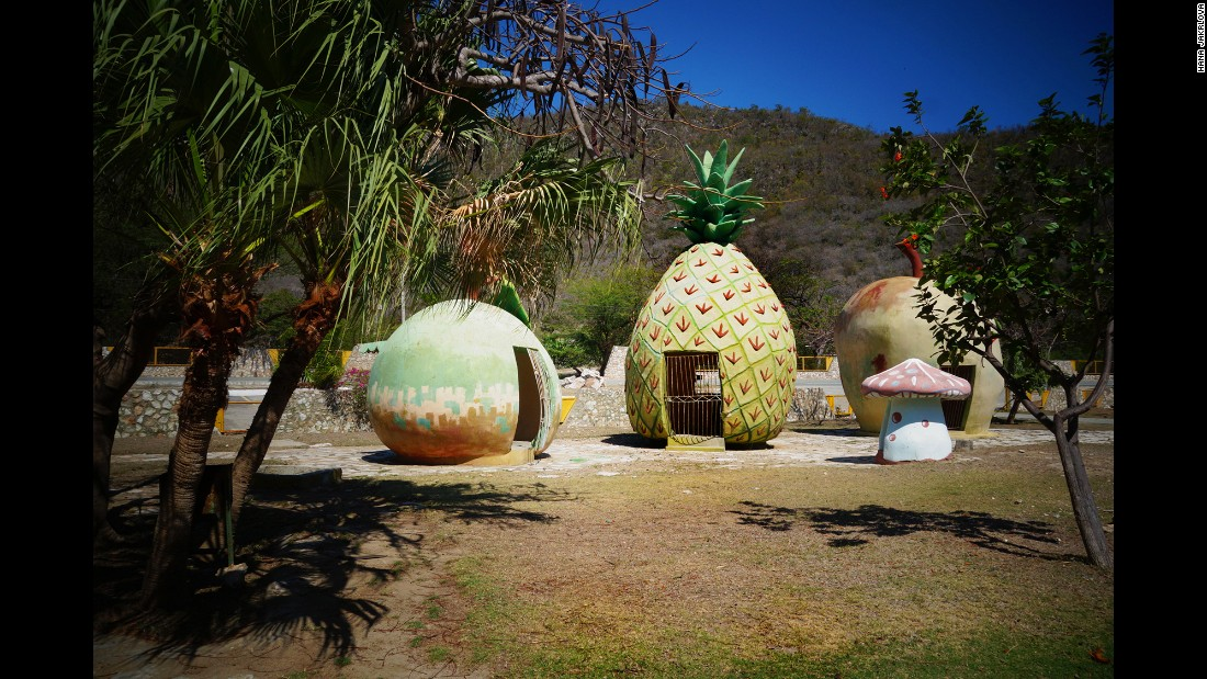 A set of fruit-shaped houses at the park.
