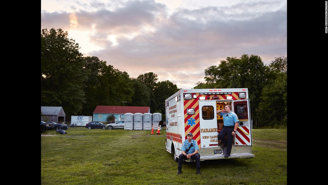 An ambulance is on hand at the CZW Tournament of Death, a wrestling event held in Townsend, Delaware, in June 2014. The performers are trying to prevent seriously hurting one another, but the wounds they suffer are very real.