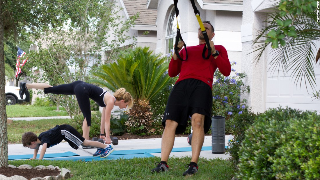 While standing, hold TRX handles with a neutral grip. Lean your body straight back so that your arms extend at chest height. Make a rowing motion by bending your elbows and pulling your chest toward the handles. Keep your body aligned and core strong throughout the motion. Don't bend from the waist.